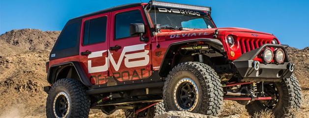 DV8 Off road Red Jeep with light bar, winch and lift kit