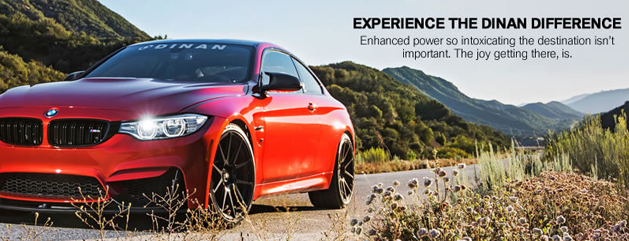 Red Dinan M4 BMW on country road