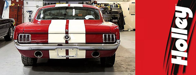 Red Ford Mustang with Holley Complete Product Line upgrade in garage at Crown Auto Parts