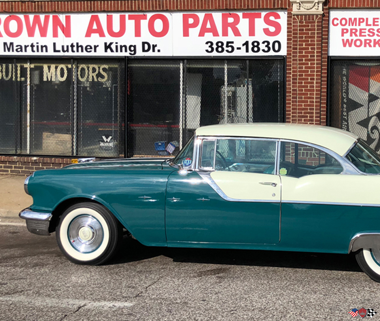 1955 Pontiac Star chief out front of Crown Auto Parts