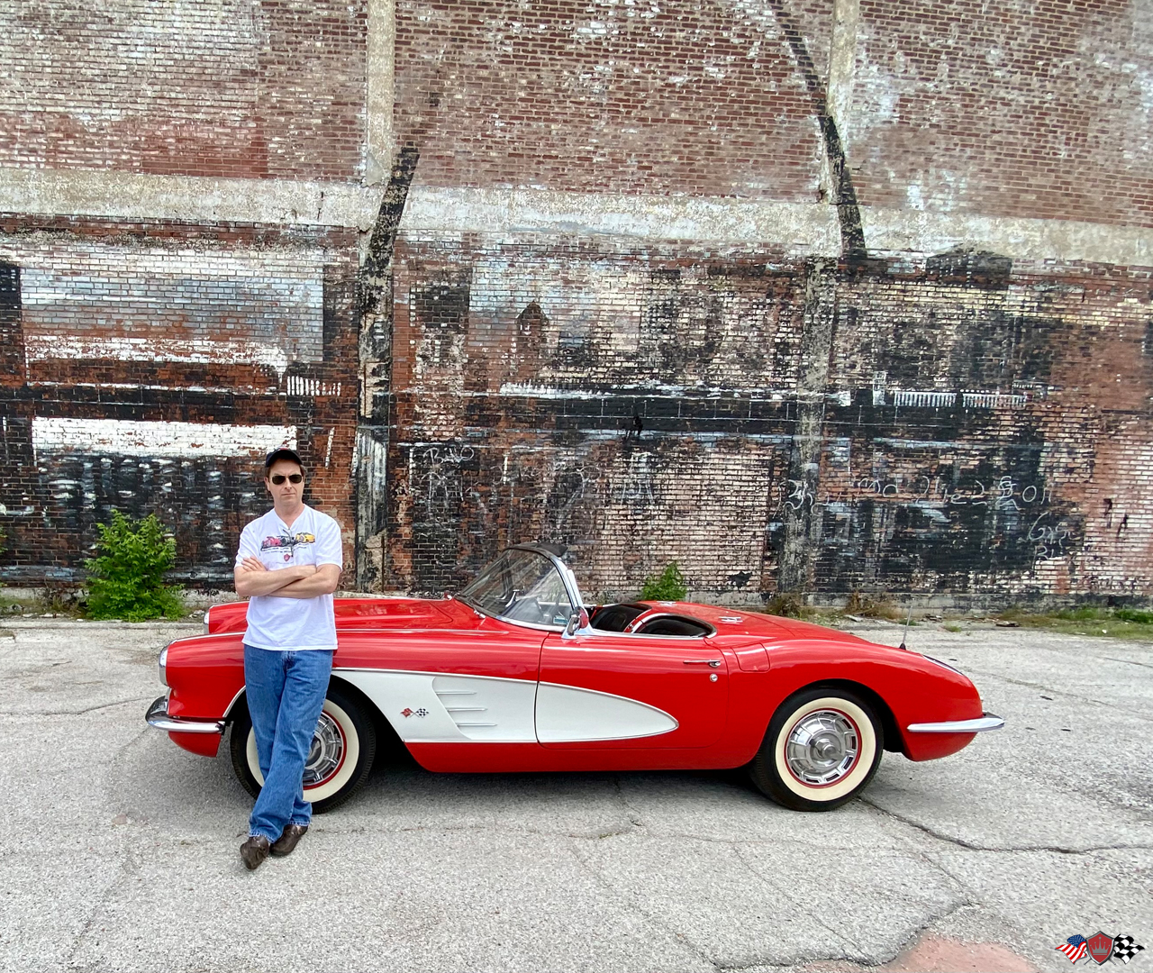 Crown Auto Parts owner Mike Horwitz with the 1960 Corvette out front of Crown's Famous St Louis Arch mural